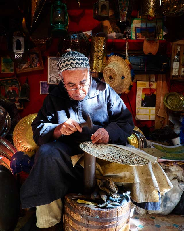 Old Moroccan man crafting