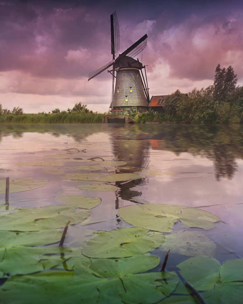 Classic windmill at dusk in Kinderdijk, Netherlands