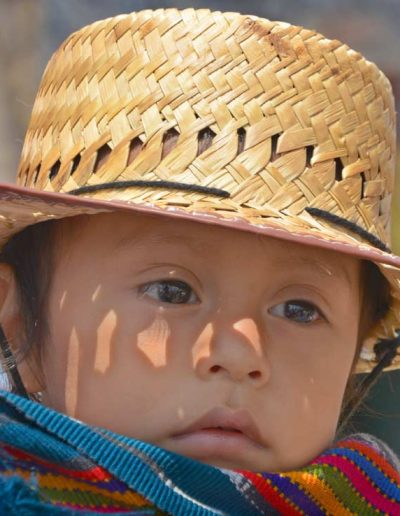 A smill child with a hat — Quetzal Motivo