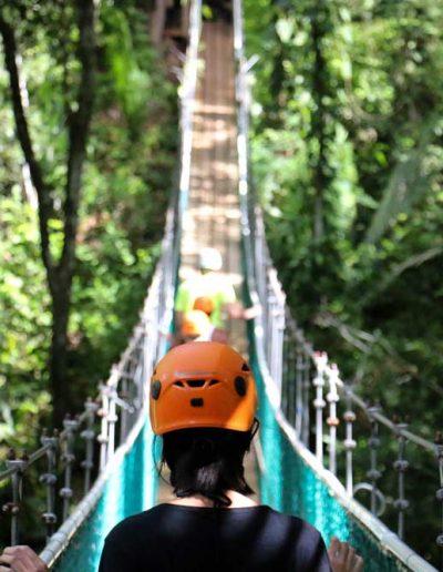 walking on a hanging bridge in Belize