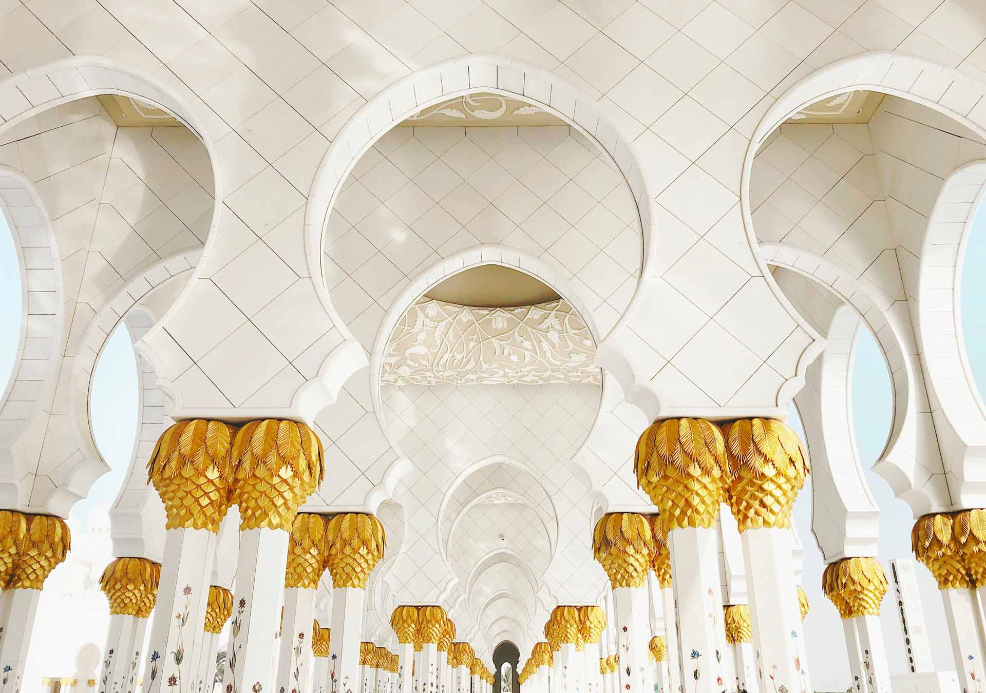 Gold and white arches of the Sheikh Zayed Mosque