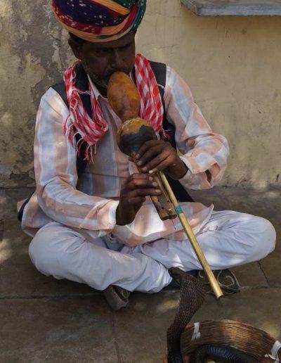 A man with a flute — Hi Tours
